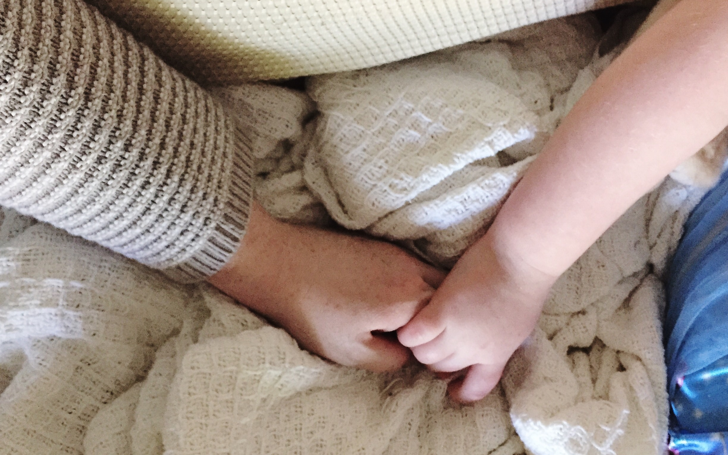 mom and daughter hold hands